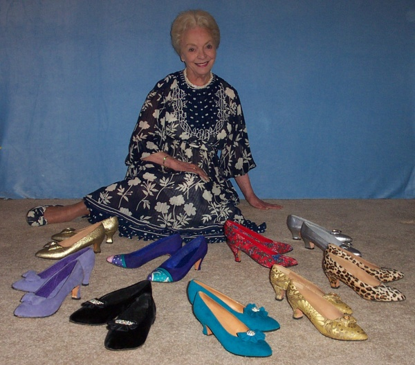 Mary with several pairs of her shoes